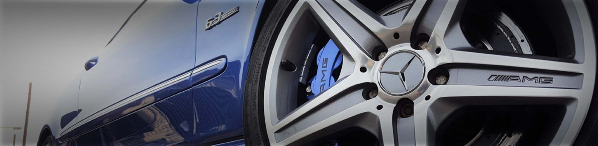 brake calipers painted blue with stenciling