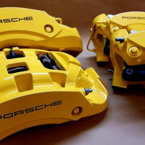 Porsche yellow brake caliper refurbishment and painting with black stenciling london