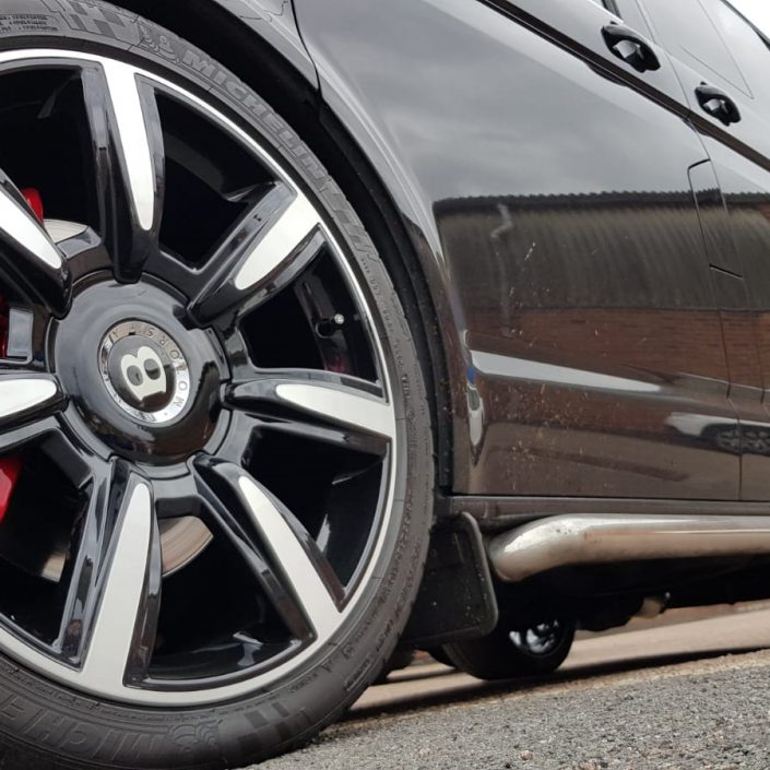 gloss black powder coat and diamond cut Bentley alloy wheels